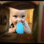 Felix looking through wooden blocks