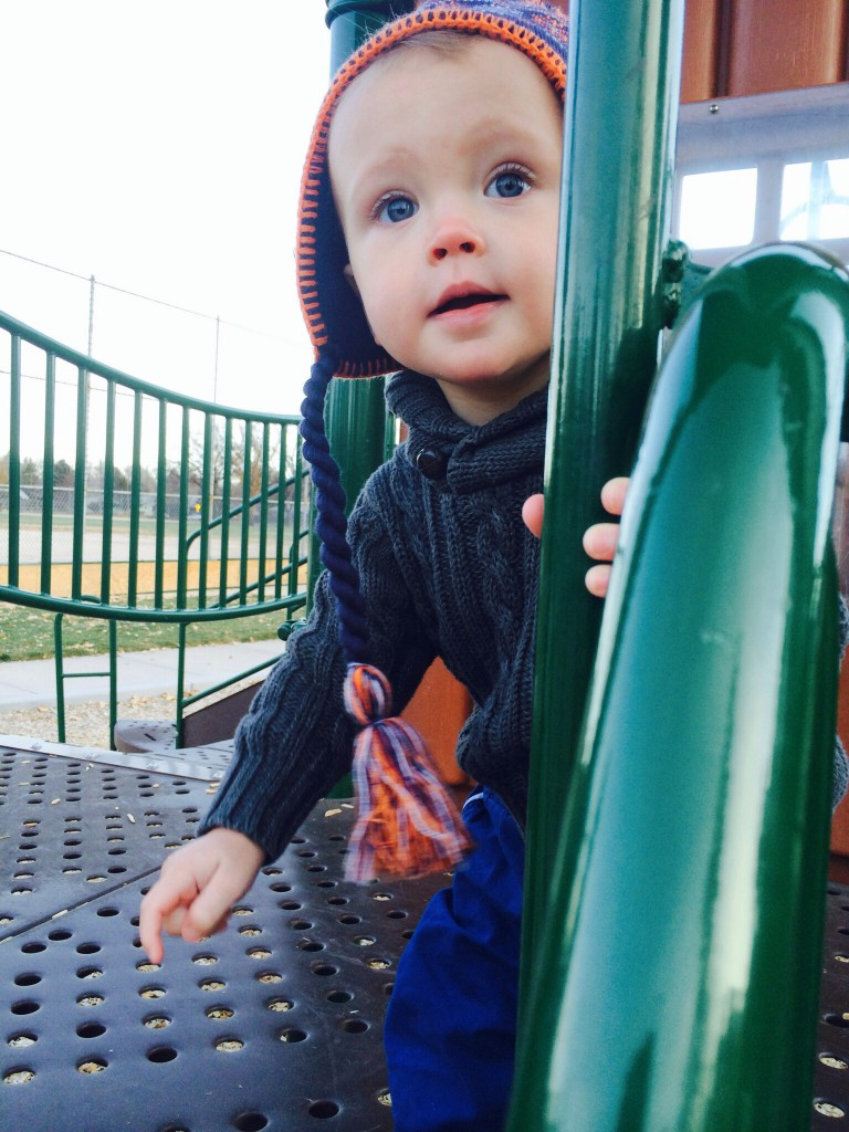 Felix plays on the playground, preparing to climb down some stairs