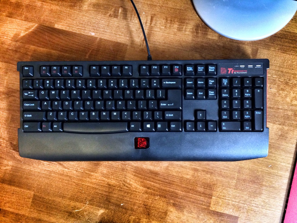 "close up of terribly named "" Thermaltake eSports KNUCKER Plunger Gaming Keyboard"""