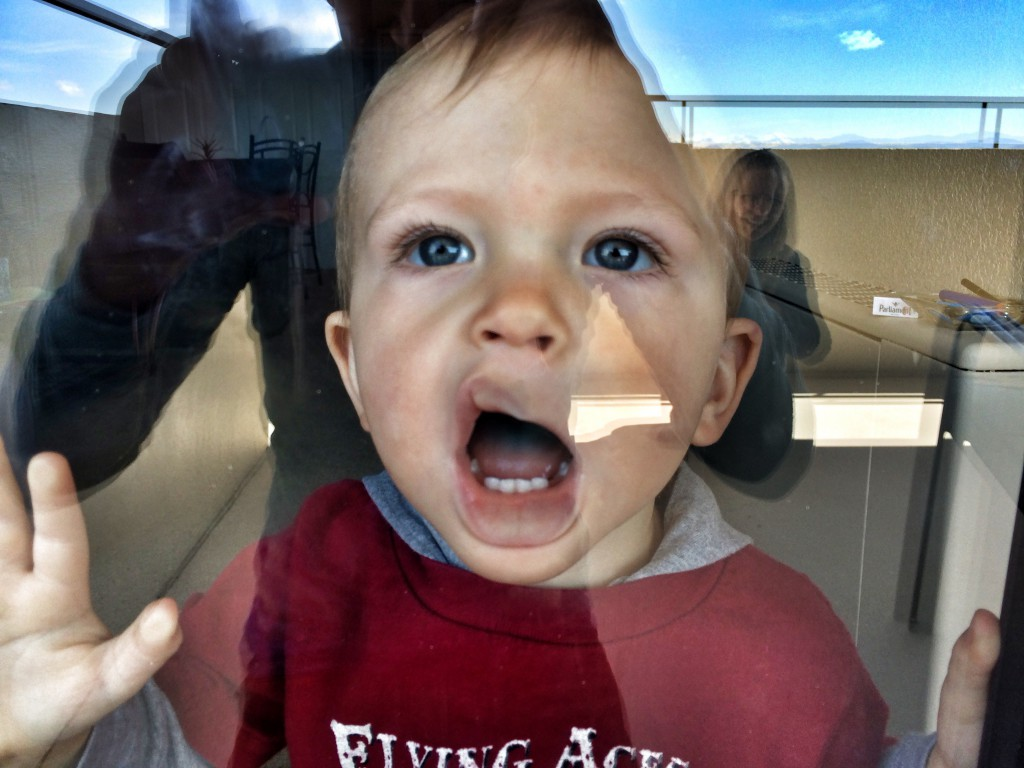 pressing his face up against the glass