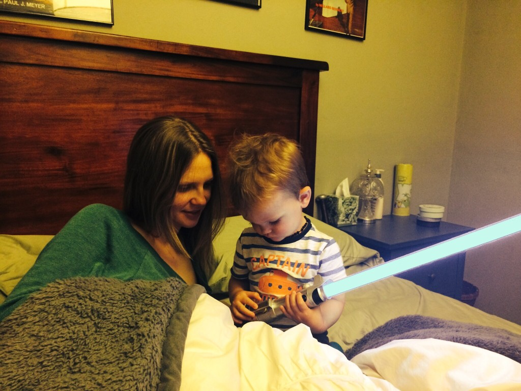 checking out various settings of his lightsaber
