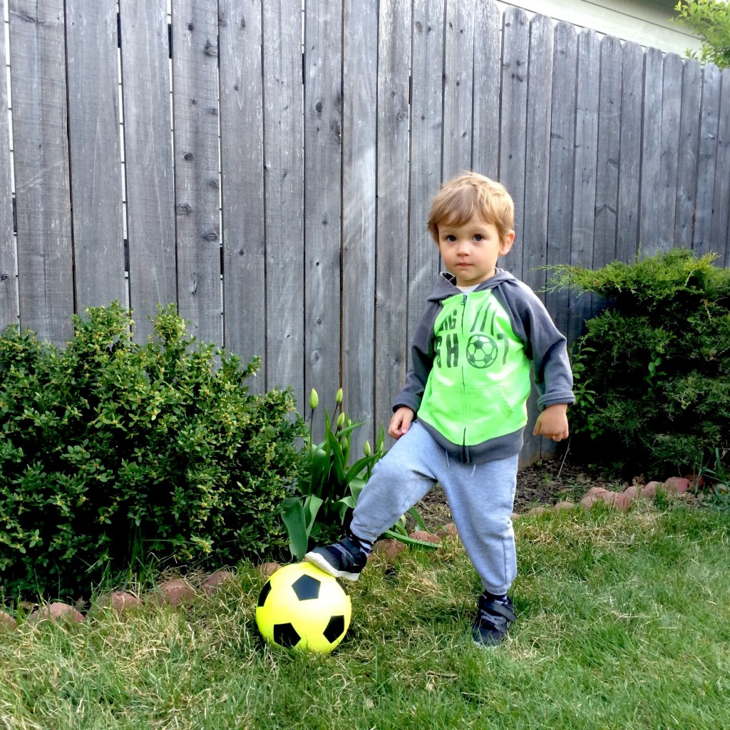 Felix poses with his soccer ball