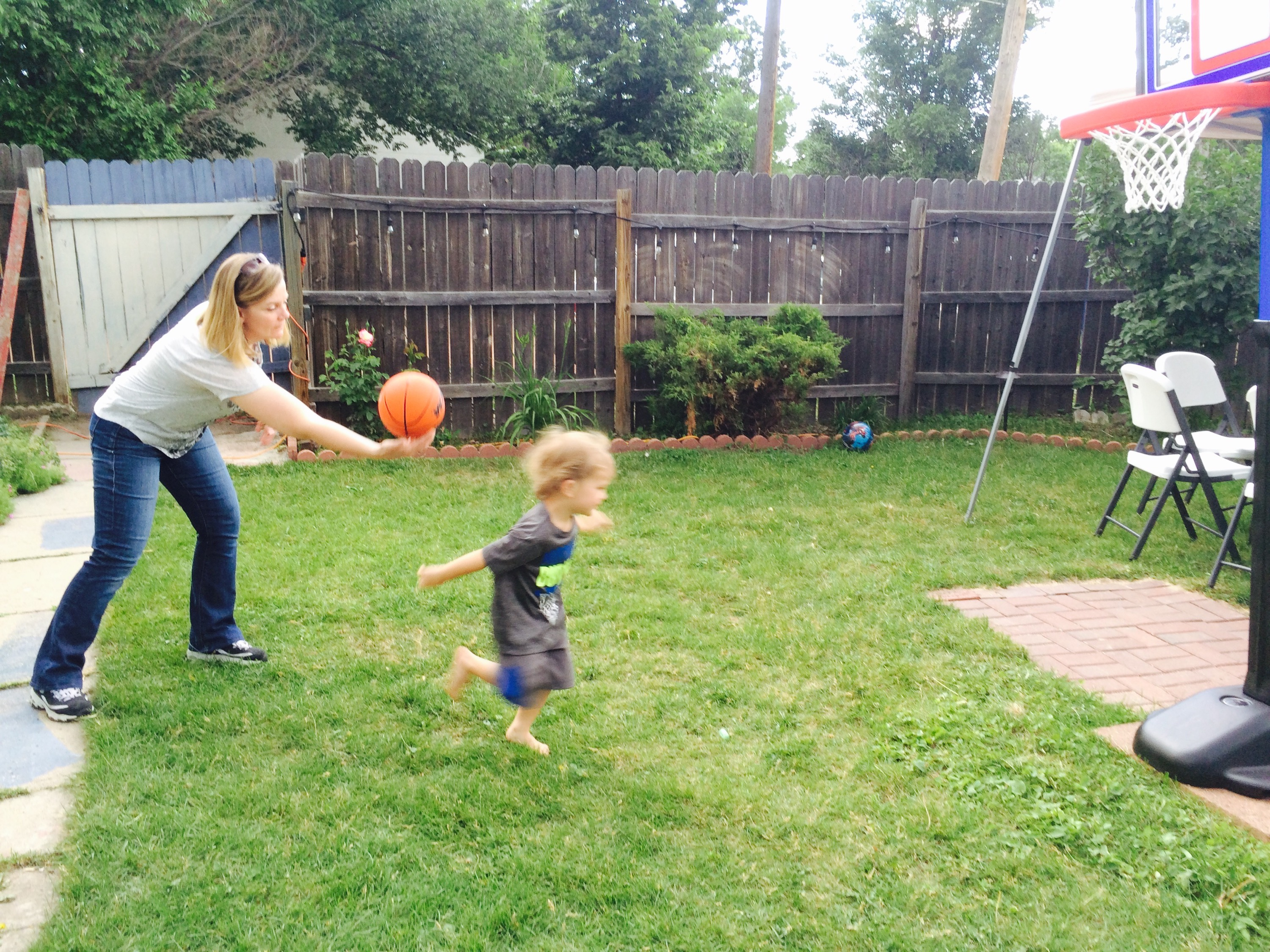 Felix and Grandma play with his new basketball hoop