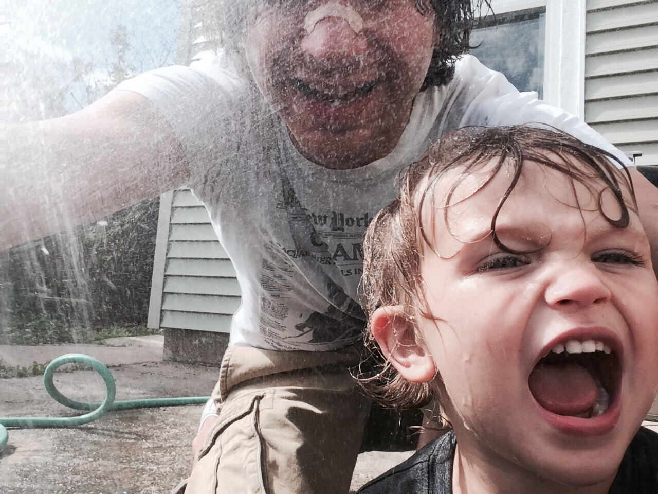 I probably shouldn't put my phone around Felix with a hose, but phone came out fine and got a fun pic!