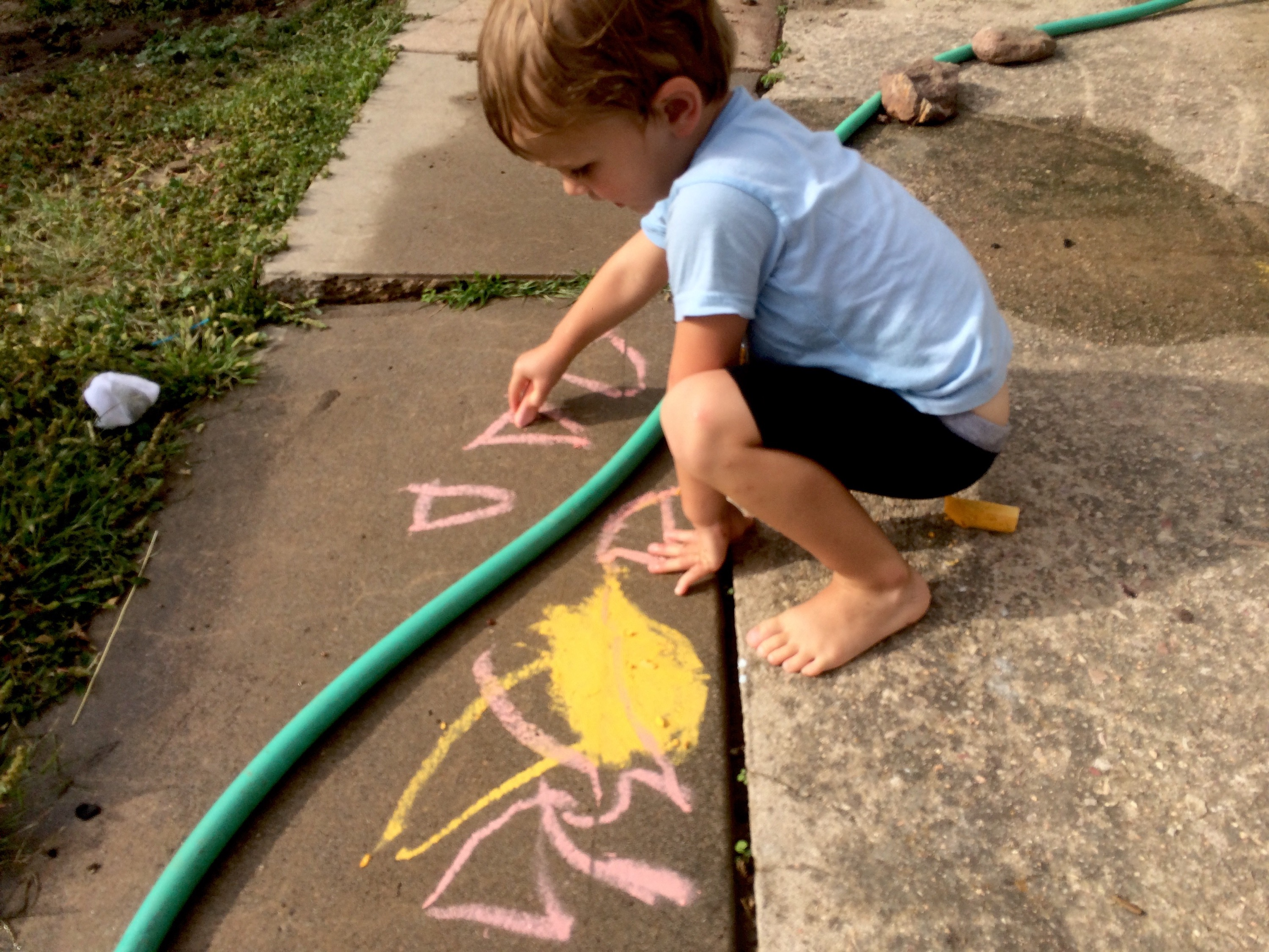 Felix draws with chalk