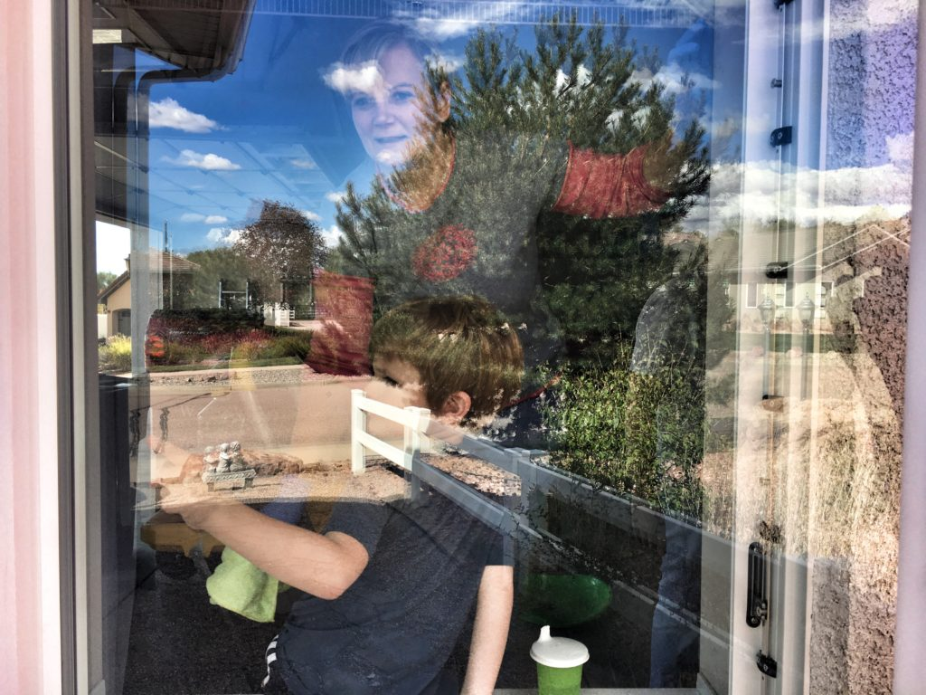 Grandma and Felix washing windows